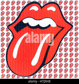 LSD blotter featuring the Rolling Stones' tongue and lips logo by Jon Pasche. Blotters are made of absorbent blotting - Stock Image