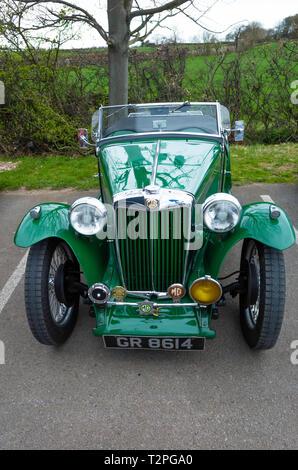 A classic British Racing Green  MG-TA roadster sports car. - Stock Image