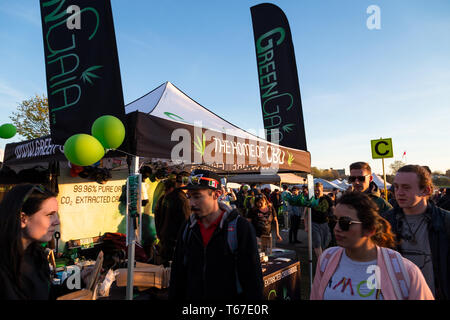 VANCOUVER, BC, CANADA - APR 20, 2019: Crowds and vendors at the 420 festival in English Bay, Vancouver. - Stock Image