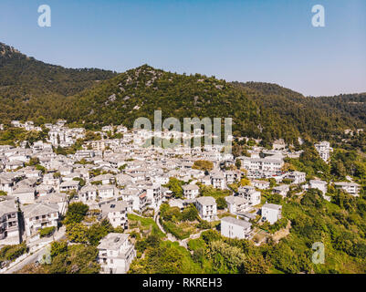 Aerial view of Panagia town in Thasos Island with traditional greek white houses and stone roof - Stock Image