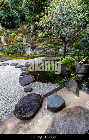 Jodoji Temple Garden is a tsukiyama garden that uses the natural hillside and its waterfall as background scenery with the focal point a small pond at - Stock Image