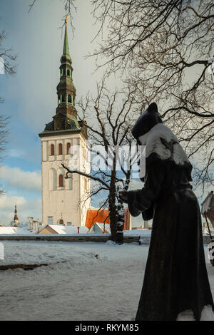 Winter day in Tallinn old town with St Nicholas church tower in the distance. - Stock Image