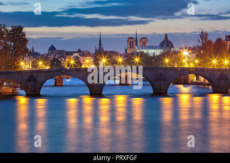 Night Seine and Pont Royal, Paris, France - Stock Image