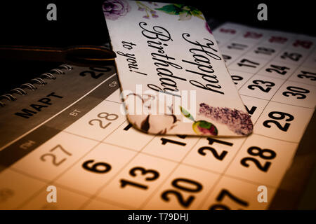 Close up of April calendar on white background - Stock Image