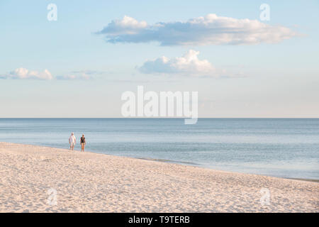 Afternoon stroll on the beach, Naples, Florida, USA - Stock Image