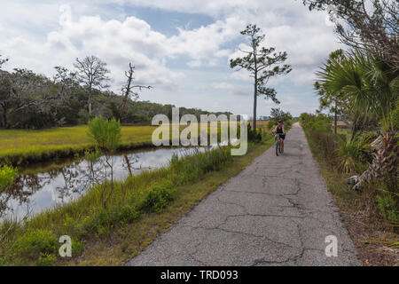Bicycle riding on Jekyll Island Bike trails Brunswick, Georgia USA - Stock Image