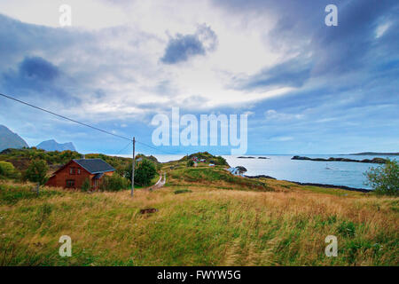 Farm houses near Hamn on the western side of island Senja in northern Norway. - Stock Image