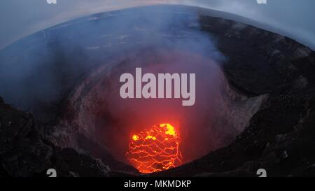View inside the Kilauea volcano summit lava lake showing a significant drop in volume as the volcanic eruption continues destroying homes, forcing evacuations and spewing lava and poison gas  May 6, 2018 in Leilani Estates, Hawaii. - Stock Image