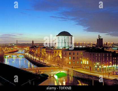 Liffey river at dusk with the Four Courts buildings featuring, Dublin Ireland - Stock Image