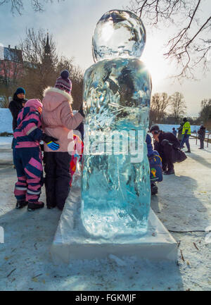 people taking family pictures with ice sculptures in the park, Tallinn, Estonia - Stock Image