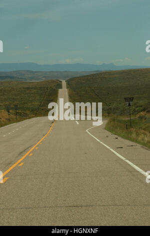 Seemingly endless straight Road in Colorado - Stock Image
