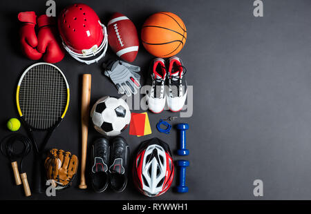 High Angle View Of Various Sport Equipment On Black Background - Stock Image