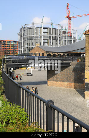 Coal Drops Yard, London's new shopping destination, at Kings Cross, in the spring sunshine, in the UK - Stock Image