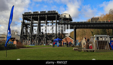 The Anderton lift with children playing in the grounds. The Canal and River Trust held a free open day at the cathedral of the waterways Cw 6614 - Stock Image