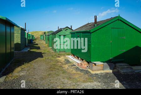 Green fisherman's huts at the South Gare Teesmouth, England UK - Stock Image