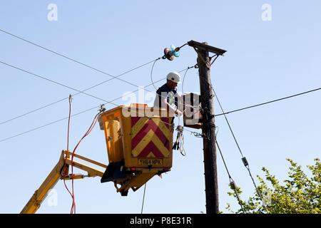 Engineer replacing electricity transformer, Llanllyfni, Gwynedd - Stock Image