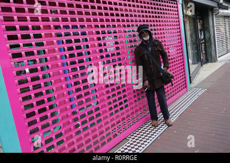 black male in front of closed shop, Brighton UK - Stock Image