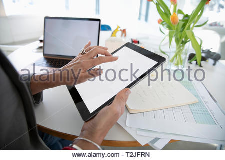 Businesswoman with digital tablet working at home - Stock Image