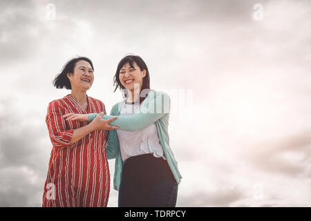 Asian mother and daughter having fun outdoor - Happy Chinese family  enjoying time together outside - Stock Image