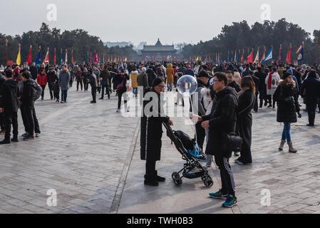 Tourists on Danbi Bridge in Temple of Heaven in Beijing, China - Stock Image