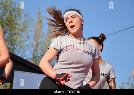 Nis, Serbia - April 20, 2019 Female practicing Piloxing outside in park on sunny day - Stock Image