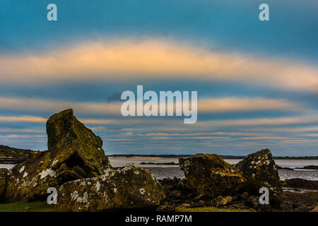 Loughros Point, County Donegal, Ireland. 4th January 2019. Ancient stones covered with lichen are seen at sunrise on the north-west coast. Credit: Richard Wayman/Alamy Live News - Stock Image