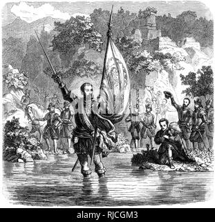 Vasco Nunez de Balboa stands in the water, holding a sword and a flag, declaring his discovery of the Pacific. His men stand behind him on land cheering. - Stock Image