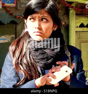 Girl with a smartphone - Stock Image