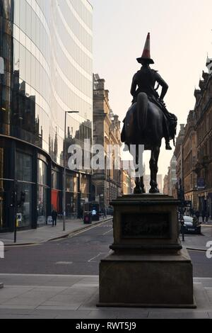 The renowned Duke of Wellington statue of horse and rider with the humorous addition of traffic cone on his head in Glasgow, Scotland, UK, Europe. - Stock Image