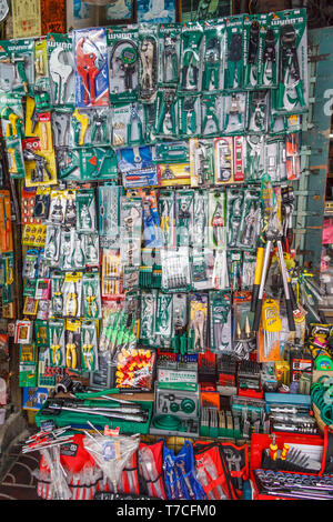Bangkok, Thailand - 7th March 2017: Products hanging up in a hardware store. Many goods are imported from China. - Stock Image