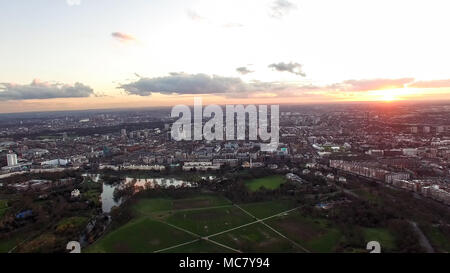 Aerial View Urban London Cityscape with Beautiful Dusk Sunset Time Sky Clouds around Regent's Park, Marylebone, St. John's Wood Neighborhood Skyline - Stock Image