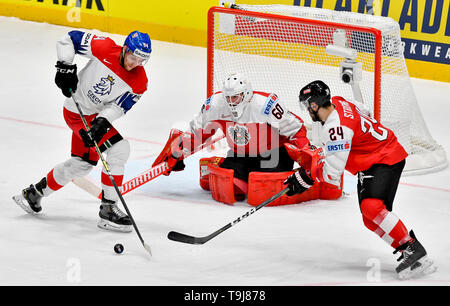 Bratislava, Slovakia. 19th May, 2019. L-R Radek Faksa (CZE) and goaltender Lukas Herzog and Steven Strong (both AUT) in action during the match between Austria and Czech Republic within the 2019 IIHF World Championship in Bratislava, Slovakia, on May 19, 2019. Credit: Vit Simanek/CTK Photo/Alamy Live News - Stock Image