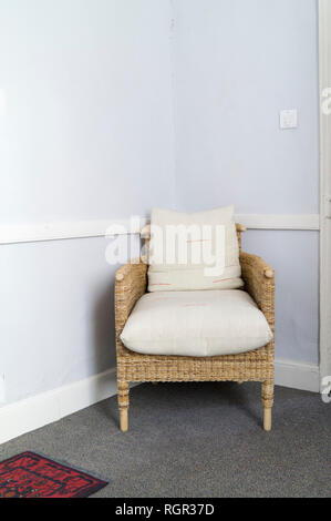 Chair in corner of room. - Stock Image
