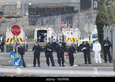 Police at the scene in Londonderry, Northern Ireland, where 29-year-old journalist Lyra McKee was shot and killed when guns were fired and petrol bombs were thrown in what police are treating as a 'terrorist incident'. - Stock Image