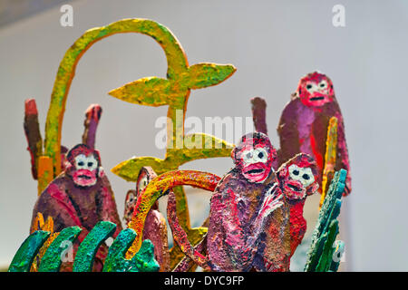 Roslyn, New York, U.S. - April 12, 2014 - Artist Hunt Slonem's colorful sculptures of monkeys, wildlife and tropical plants, are part of the Garden Party exhibit at the Nassau County Museum of Art on Long Island. Credit:  Ann E Parry/Alamy Live News - Stock Image