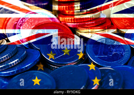 Lots of euro coins with the flags of the United Kingdom and the European Community. Brexit metaphor. - Stock Image