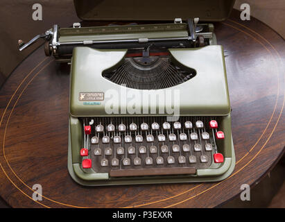Vintage antares Little Star portable typewriter inside antiques centre, Marlesford Mill, Suffolk, England, UK - Stock Image
