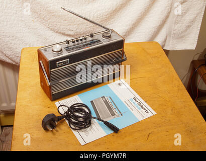 1970s Roberts R606MB portable radio with mains lead and service manual - Stock Image