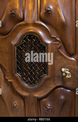 A wooden door panel inside the Casa Batllo building designed by Antoni Gaudi, Barcelona, Spain - Stock Image