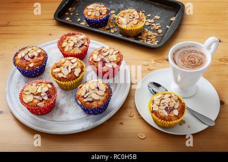 Orange raspberry almond muffins - Stock Image