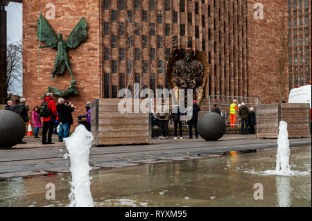 Coventry, West Midlands, UK. 15th March, 2019. The Knife Angel which was installed at Coventry Cathedral yesterday drew big crowds of spectators today.  The country is currently in a grip of knife violence. It is hoped the sculpture will highlight the issue and have a positive effect on the public. Credit: Andy Gibson/Alamy Live News. - Stock Image
