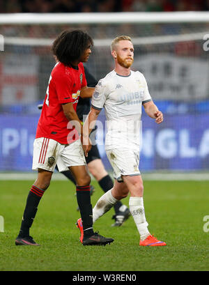 Optus Stadium, Burswood, Perth, W Australia. 17th July 2019. Manchester United versus Leeds United; pre-season tour; Tahith Chong of Manchester United tries to shake hands with an angry Adam Foresaw of Leeds United Credit: Action Plus Sports Images/Alamy Live News - Stock Image