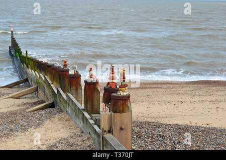 Pebble towers on the wave breakers at Southwold Beach in Suffolk, UK - Stock Image