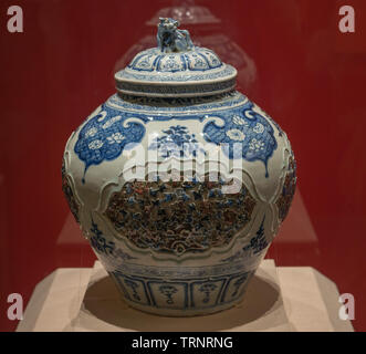 Blue and White Underglaze Red Jar with Hallowed-out Lid. 1271 AD - 1368 AD(Yuan Dynasty).  Hebei Museum, China - Stock Image