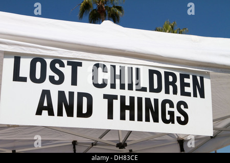 Lost Children and things sign at the Tustin Dino dash road race in Southern California - Stock Image