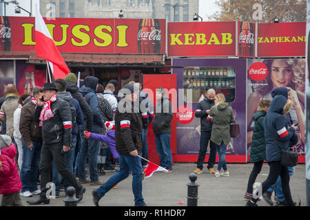 Warsaw, Poland, 11 November 2018: people during celebrations of Polish Independence Day in front of kebab shop - Stock Image