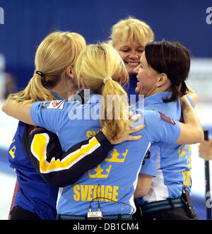 Eva Lund (L-R), Anna Svaerd, Anette Norberg and Cathrine Lindahl of Sweden's national women's curling team - Stock Image