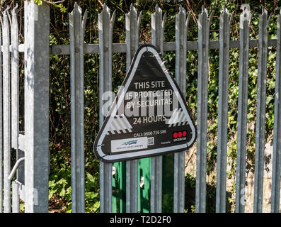 Securitas sign on a steel fence, 24 hour security, notice, - Stock Image