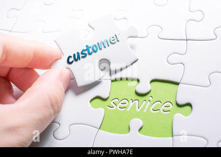 The Words Customer And Service In Missing Piece Jigsaw Puzzle - Stock Image