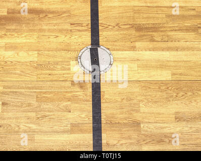 Protection circle cap of a electrical outlet in wooden floor. Painted lines on wooden floor of sporting hall with sratched surface. - Stock Image